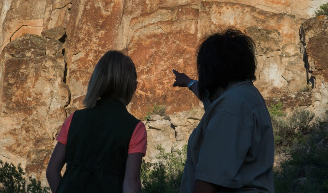 People look at petroglyphs at Freemont State Park