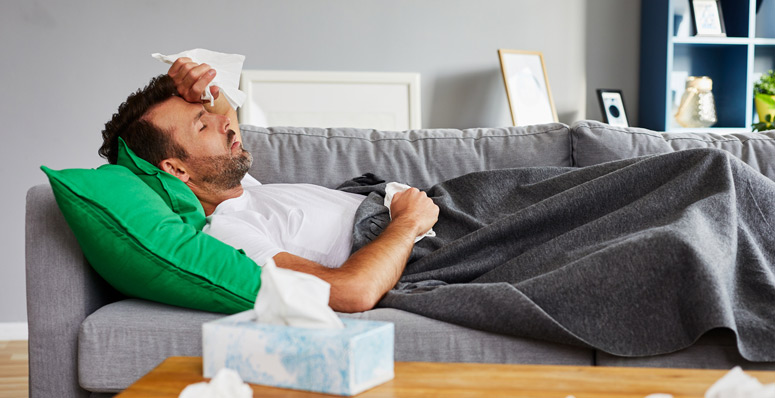Sick man on couch